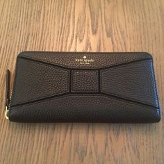 PM Editor Pick~Kate Spade Black Bow Leather Wallet Kate Spade Black Pebble Leather Bow Zip Around Wallet. Super cute wallet with 12 credit card slots, 2 Bill Folds, 3 Compartments and a Zipper Coin Pocket. Price is rock bottom. If you would like more discount please bundle. 2 Items 10% Off 3 + Items 15% Off kate spade Bags Wallets