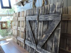 Your Choice of a pair of Z style or 3 style in a four slat configuration 14 X 36 shutters. These Reclaimed rustic wood shutters are sized to go with