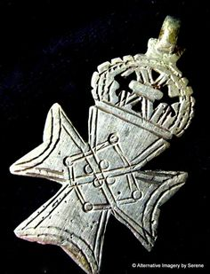 Old Ethiopian Coptic Cross(number 5) imported from Addis Ababa, Ethiopia. This cross is a silver alloy (coin silver) and may very well date back to the turn of the 20th century.These crosses were hand cast and no two are the same. There are strong details that resemble Celtic-like interlaced designs though the Ethiopian coptic cross designs are some of the earliest Christian crosses found.   by TemplesTreasureTrove, $44.95