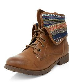 - Aztec knit cuff- Lace up fastening- Cleated sole