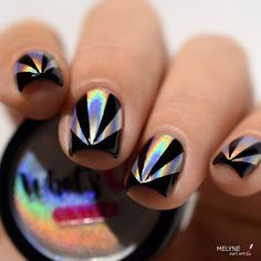For the disco party at the club will certainly be a good solution this manicure. The black color is dark, but it is refreshed with the silver triangles.
