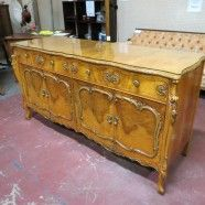 SOLD $800 / Vintage antique French style carved burled birds eye buffet credenza  c. 1920. Serpentine front. 2 drawers, 2 doors. Carved throughout front and sides. Cabriole legs, carved frame on doors showcase a rare burl. Glass top too! This would be great in a living room or a dining room. High quality piece. Excellent condition