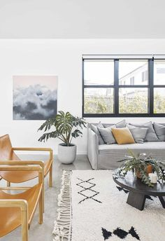 "Living area: Greer has chosen pieces that are hardy enough to withstand the rigours of family life. ""It's nice not to rush in and buy new things right away,"" she says. ""It's important to live in the space first."" The 'Bronte' linen sofa is from Urban Couture."