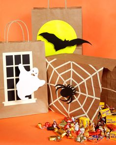 Trick-or-Treat Bags | Martha Stewart Living - These clever trick-or-treat bags are simple to construct and help keep children safe because they glow in the dark.