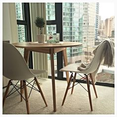 Creme coloured Eames Side Chairs in, Vancouver, Canada