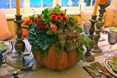 Fall tablescape. Centerpiece. Heirloom pumpkin, blue & green hydrangea, sunflowers, mums, variety of leaves