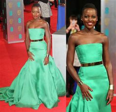 Lupita Nyong'o looked simply stunning at the 2014 British Academy of Film and Arts awards ceremony in London wearing a kelly green Christian Dior Couture gown and Ana Khouri jewelry.RELATED: Oscar trends of years past