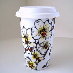 Adding a bunch of floral and tropical themed mugs to my Etsy shop. White orchids by sewZinski