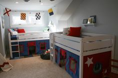 These loft beds and bed curtains make the perfect play space in this shared boys room!