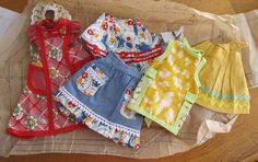 These tiny vintage aprons are going in my laundry room on a string with tiny red clothes pins!