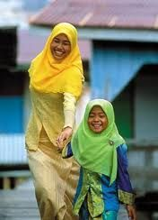 Mother and daughter in very traditional muslim outfit in  Brunei Darussalam