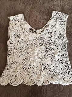 Top female, made crochet knitting combined. The left side of Irish lace with…