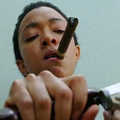 Sasha Williams  (Sonequa Martin-Green) with one of Sgt. Abraham Ford's cigars in The Walking Dead S7E05