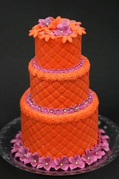 etro orange and pink funky wedding cake, decorated with hand crafted pink and orange flowers. From www.torteditoni.com gold weddings, funky cakes, pink cakes, wedding ideas, orange weddings, cake decor, autumn weddings, wedding cakes, orange flowers