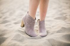 """Suede, taupe ankle booties with perforated detail and a 3"""" heel"""