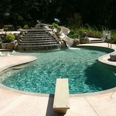 Inground Pools With Diving Board And Slide wooden diving board luxury pools builders & designers | luxury