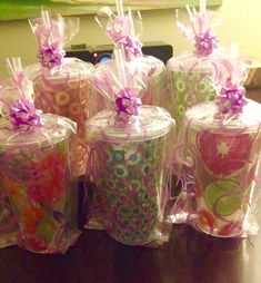 Co-ed baby shower prizes. Cups, bags, bows and plastic filling from the Dollar Tree plus $5 Starbucks gift cards.
