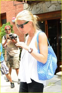 Gwyneth Paltrow left the Hamptons to join Faith Hill for lunch in NYC today. The actress is close with Faith and her husband, Tim McGraw, who plays Gwyneth's Hermes Watch, Goyard Bag, Cartier Tank, Faith Hill, Gwyneth Paltrow, Hermes Kelly, Bag Accessories, Harem Pants, Husband