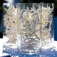 Clusters of tall glass cylinders filled with white starfish continued the beachside ambience beneath the reception tent. - Wedding Day Pins : You're Source for Wedding Pins! Beach Wedding Centerpieces, Reception Decorations, Summer Centerpieces, Candle Centerpieces, Reception Ideas, Table Decorations, Wedding Reception, Our Wedding, Friend Wedding