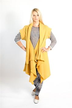 Yellow woollen cardigan features in front light drapes, short sleeves and beautified with contrasting color seams. The cardigan may be turned upside down and you will get a shorter with more front drapes cardigan.