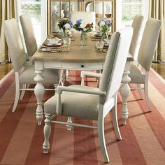 Complete the set with two upholstered arm chairs and four side chairs, which feature a modern shape with classic details. The upholstered back is tall and simple in shape, with a space between the back and seat to keep the look more classic than modern.