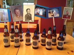 Centerpieces for hubby's 50th! Appropriate for a beer guy, eh? Photos on both sides of each dowel (one side from the early years & the other more recent). Flowers in 6, photos in other 6. Let the party begin!