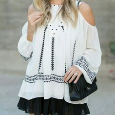 White Blouse It is a cold shouldered tribal embroidered blouse. It is brand new. Boutique 9 Tops