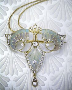 Art Nouveau gold diamond and enamel plique-a-jour pendant