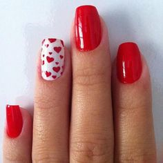 Valentine's Day Beauty Inspiration: Turn up the heat on your red mani with a heart pattern accent nail.