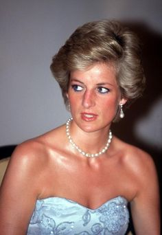 The Princess of Wales attends a banquet at the president's palace in Yaounde, Cameroon, wearing a blue Catherine Walker dress, March 1990. (Photo by Jayne Fincher/Princess Diana Archive/Getty Images)