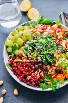 Detox Crunch Salad. A vegan salad full of grapes, apples, celery, pistachios, pomegranates, walnuts, and carrots. | This Healthy Table