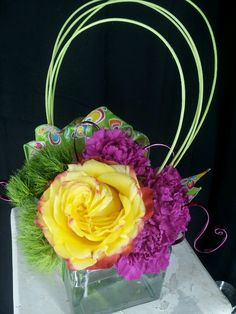 Green trick dianthus,  carnations,  and standard rose accented with aluminum wire.