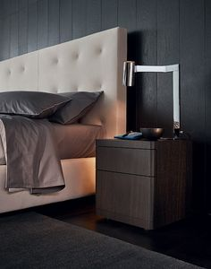 Arca bed with quilted headboard, 01 latte Nabuk leather removable covering. Bed-set in 06 roccia and 08 polvere Provence with white piping stitching style. You night table in spessart oak.