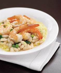 Lemony Shrimp With White Beans and Couscous:      1 1/2 cups couscous      kosher salt and black pepper      3 tablespoons unsalted butter      2 cloves garlic, chopped      4 scallions, chopped      1 pound medium shrimp, peeled and deveined      1 15.5-ounce can cannellini beans, rinsed      1/2 cup fresh flat-leaf parsley      2 tablespoons fresh lemon juice