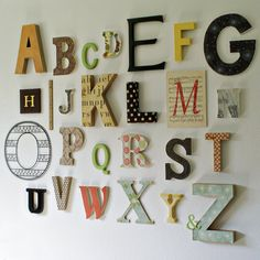 Alphabet wall for a nursery! will have one some day! @Shaina Pearce this can be something fun for the guests at the baby shower that you will be throwing for me (sometime in the NOT near future). each guest is assigned a letter and they bring it decorated to the shower! love love love. =)