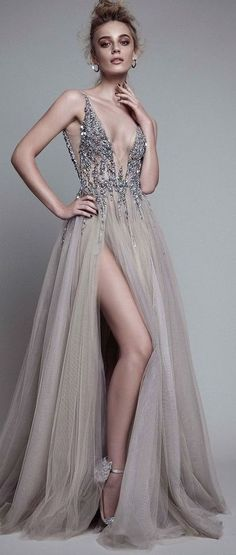 Featured Wedding Dress: Berta; Glamorous silver embellished v-neck bodice wedding dress with thigh high slit tulle skirt;