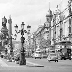 O'Connell Street early Nelson Pillar in the background which was bombed in 1966 and later replaced by the Spire Ireland Pictures, Images Of Ireland, Old Pictures, Old Photos, Photo Engraving, Ireland Homes, Dublin City, Vw, 1960s
