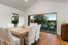 | HOME AMONG THE TREE TOPS brought to you by Indigo Property Marketing #balcony #bifolddoors #outdoorentertaining #floorboards #pitchedceiling #diningroom #morningtonpeninsula #coastal #coastaldecor #entertaining deck #deck Double Drawer Dishwasher, Timber Vanity, Double Carport, Stone Bench, Heated Towel Rail, Light And Space, Tree Tops, New Carpet, Outdoor Entertaining