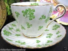 Mom had one of these in her teacup collection. AYNSLEY GREEN SHAMROCK TEA CUP AND SAUCER SWIRL TEACUP DESIGN ENGLAND.