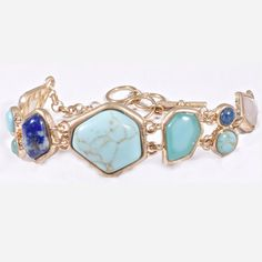 "Inspired by the French Riviera, this breathtaking bracelet features genuine lapis, turquoise, aquamarine and agate stones set in a brushed vintage gold finish. Riviera Bracelet - $60   - Vintage gold with genuine lapis, turquoise, aquamarine and agate   - 7.5"" with 1.5"" extender  - Toggle Closure  - Made of natural stones that are subject to slight variations in color"