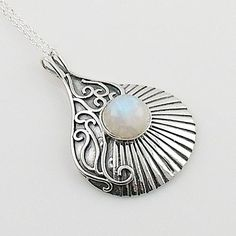 "Moonstone set in solid sterling silver artisan crafted pendant. DETAILS: * Moonstone Pendant * 3.9 g total weight * Set in SOLID .925 Sterling Silver * Stamped .925 * Measures approximately 1 1/2 "" x"