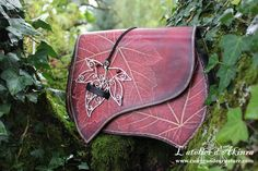 Here is a unique piece of leather : a leaf embossed bag with a custom closing made by a french jewelry maker. Fully handmade. Size : around 30x25x9cm If you like my work, you can see work in progre...