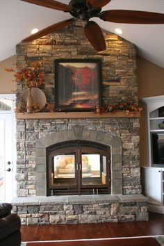 This is the fireplace I want/need in my house!!! Seen from both indoors and outside, and the design is gorgeous!