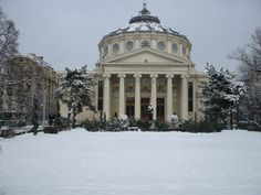 """The Atheneum is a landmark of Bucharest; was opened in 1888 and nowadays it is a host for concerts and other cultural events. In the park in front of the Atheneum stands as a """"guardian angel&… Cultural Events, World Traveler, Four Seasons, Bucharest Romania, Tours, City, Winter, Places, Concerts"""