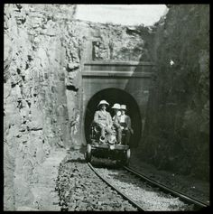 Group on inspection trolley emerging from tunnel. - Atom site for DRISA Access Point Name, Latitude Longitude, Group
