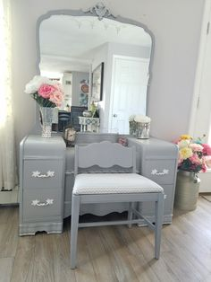This elegant 5 drawer mid-century waterfall vanity, mirror and chair. I did this one in rustoleums chalk grays, silver detail, white and silver sprayed knobs. Then added this white and silver fabric. Upcycled, repurposed, reloved and DIY