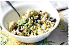 super-healthy, raw food salad with quinoa, fresh corn, black beans, avocado and lime juice