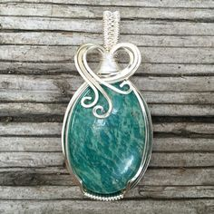 Hey, I found this really awesome Etsy listing at https://www.etsy.com/listing/238899389/russian-amazonite-wire-wrapped-pendant