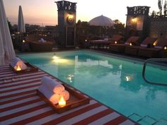 PETIT ERMITAGE | The hotel's private rooftop club is fashioned after a private salon, with 360-degree views of the Hollywood Hills. It boasts a heated saltwater pool, Masters Lounge, cabanas, a sunken outdoor living room -- complete with cozy couches, fur blankets, and fireplace -- and the Butterfly Bar (it's actually a registered hummingbird and butterfly sanctuary).