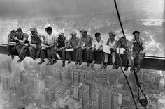 New York Construction Workers Lunching on a Crossbeam  Construction workers eat their lunches atop a steel beam 800 feet above ground, at the building site of the RCA Building in Rockefeller Center.